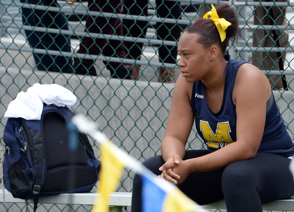 Description of . Muir's Tierra Adams after competing in the division 4 shot put during the CIF Southern Section track and final Championships at Cerritos College in Norwalk, Calif., Saturday, May 24, 2014. 