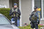 Police investigate the home of the mother of the alleged triple-murder Christopher Dorner in La Palma, California on February 8, 2013.