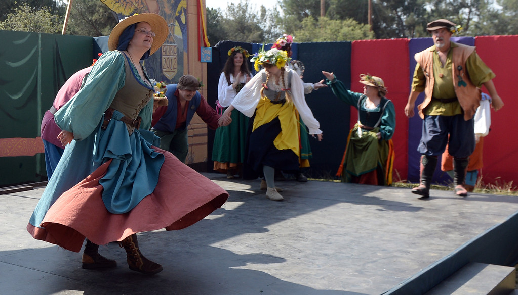 Description of . Performers dance on opening day of the Renaissance Pleasure Faire at Santa Fe Dam Recreation Area in Irwindale, Calif., on Saturday, April 5, 2014. 