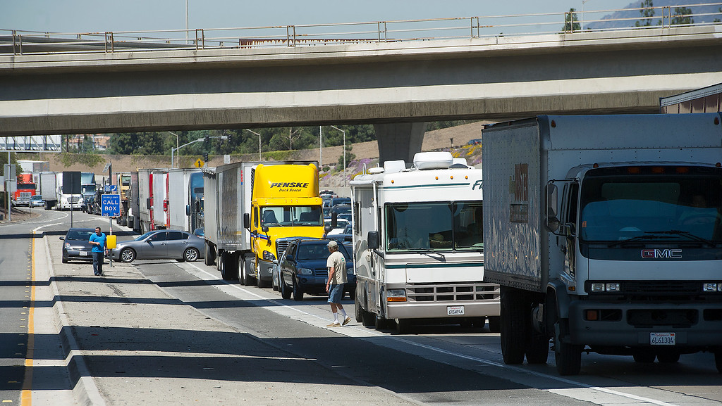 Description of . Traffic stopped on the (210) freeway near Mt. Olive offramp. A tour bus on its way to an Indian Casino tangled with two other cars on the (210) freeway near Irwindale offramp, causing the bus to flip over on its side on the freeway embarkment Thursday, August 22, 2013.  Fifty-Five people were injured and five people were air-lifted by helicopters to trauma centers.  The cause of the bus accident is under investigation.(SGVN/Photo by Walt Mancini)
