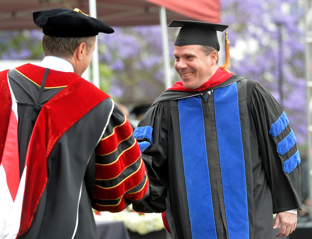 Description of . Gregory Smith receives his diploma during the Commencement Ceremony at Biola University in La Mirada on Friday May 23, 2014. Kay Warren, International speaker and author, gives the commencement address. (Photo by Keith Durflinger/Whittier Daily News)