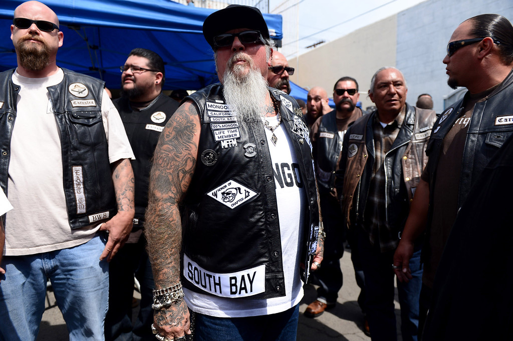 Description of . Rags, of the South Bay Chapter of the Mongols, center, attends a rally Saturday, March 29, 2013 at The House Lounge in Maywood in support of the Mongols who are facing a federal trial seeking to take away their trademark patch. (Photo by Sarah Reingewirtz/Pasadena Star-News)