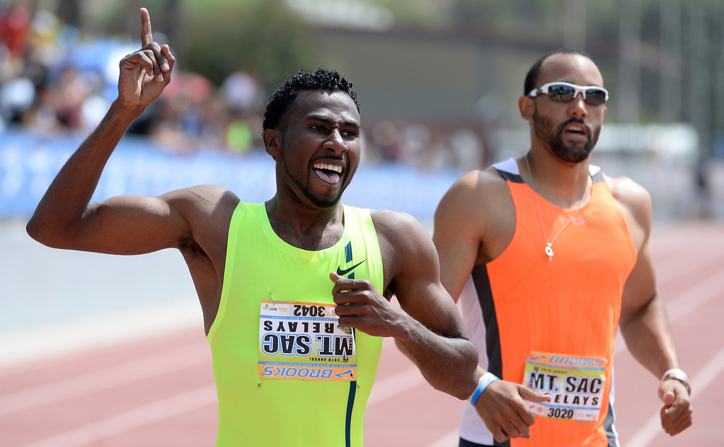 Description of . Yousef Masrah reacts after winning the 400 meter Dash Invitational Elite during the Mt. SAC Relays in Hilmer Lodge Stadium on the campus of Mt. San Antonio College in Walnut, Calif., on Saturday, April 19, 2014. 