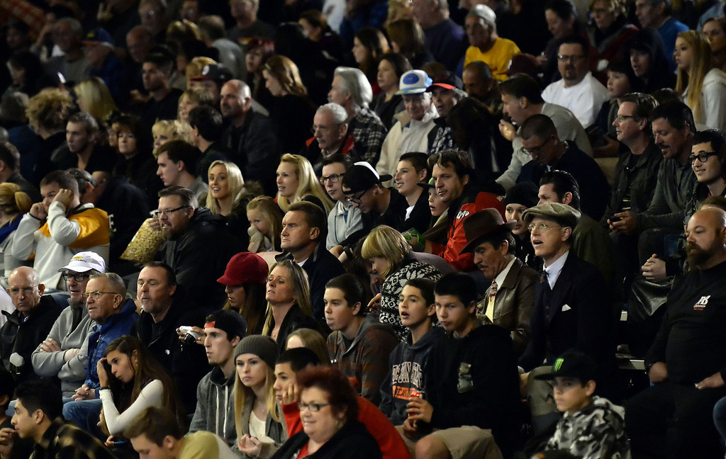 Description of . Hundreds of fans look on during the first race during the Monster Energy Speedway Cycles at the Industry Speedway in the Industry Hills Grand Arena in Industry, Calif., on Saturday, Dec. 28, 2013.     (Keith Birmingham Pasadena Star-News)