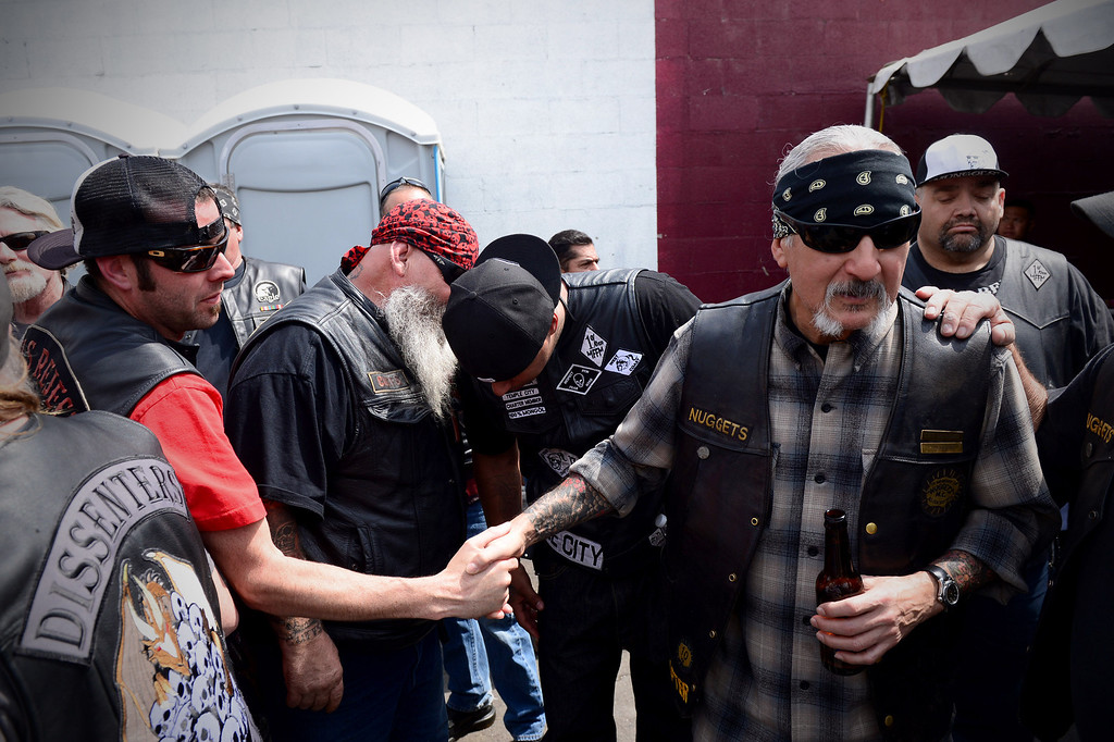 Description of . Motorcycle club members rally Saturday, March 29, 2013 at The House Lounge in Maywood in support of the Mongols who are facing a federal trial seeking to take away their trademark patch. (Photo by Sarah Reingewirtz/Pasadena Star-News)