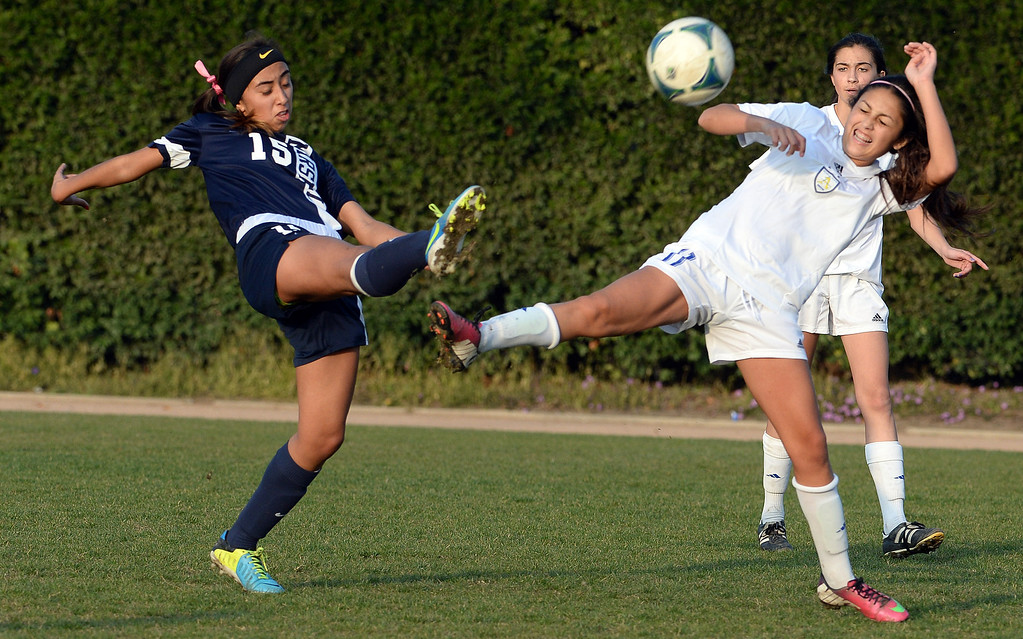 Description of . Marshall's Cassandra Bermudez (15) fights for the ball with Bishop Amat's Alexa Ruiz (11) in the first half of a prep soccer match at Bishop Amat High School in La Puente, Calif., on Thursday, Jan. 9, 2014.Amat won 3-0. (Keith Birmingham Pasadena Star-News)