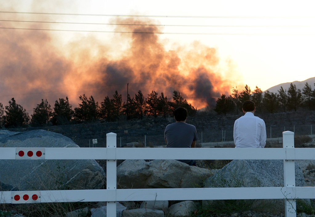 Description of . Residents watch the Etiwanda Fire from Wilson Avenue as the sun sets in Rancho Cucamonga, CA, Wednesday, April 30, 2014. (Photo by Jennifer Cappuccio Maher/Inland Valley Daily Bulletin)