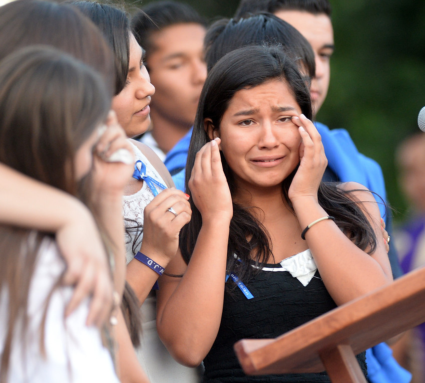 Description of . Emerald Fimbres, cousin of Adrian Castro, cries during a memorial gathering for him at El Monte High School Monday evening April 14, 2014. Castro was one of nine students killed in the bus crash in Orland, Calif. (Staff Photo by Keith Durflinger/San Gabriel Valley Tribune)