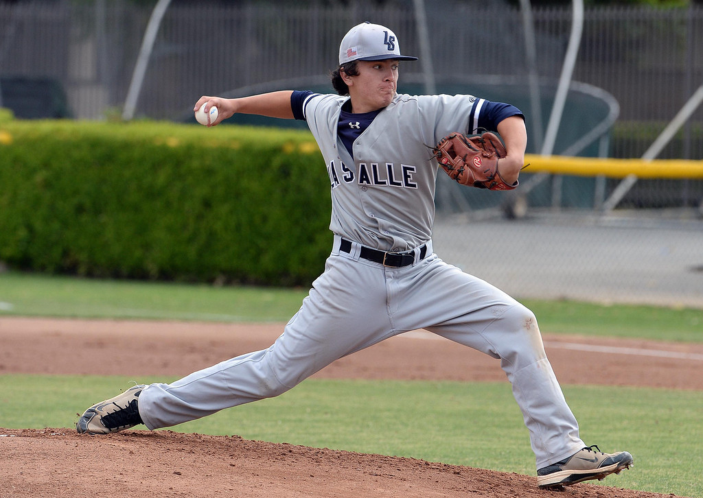 Description of . La Salle starting pitcher Brandon Jenkins throws to the plate against Bishop Amat in the first inning of prep baseball game at Bishop Amat High School in La Puente, Calif., on Tuesday, May 6, 2014. (Keith Birmingham Pasadena Star-News)