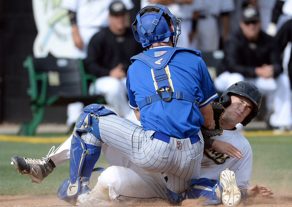 Description of . San Dimas catcher Daniel Millwee (C) (8) tags out Northview's Jake Harrison (C) on a squeeze play in the fourth inning of a prep baseball game at Northview High School in Covina, Calif., on Wednesday, March 26, 2014. San Dimas won 2-0.
