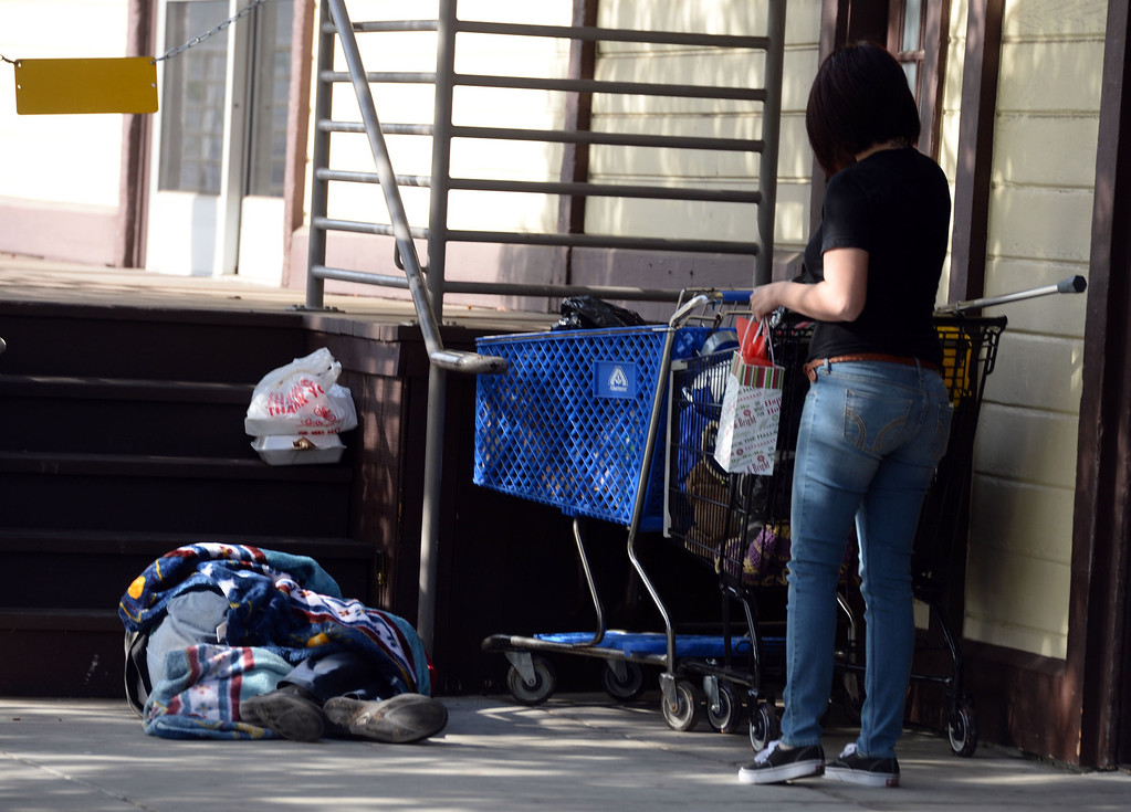 Description of . Jessica Zuniga leaves a gift bag for a homeless man that was sleeping on the grass at the Whittier transportation Center in Whittier, Calif., on Saturday, Jan.4, 2014. Zuniga was given a large sum of money by an unidentified man at Target when he thought she had no money.   (Keith Birmingham Pasadena Star-News)