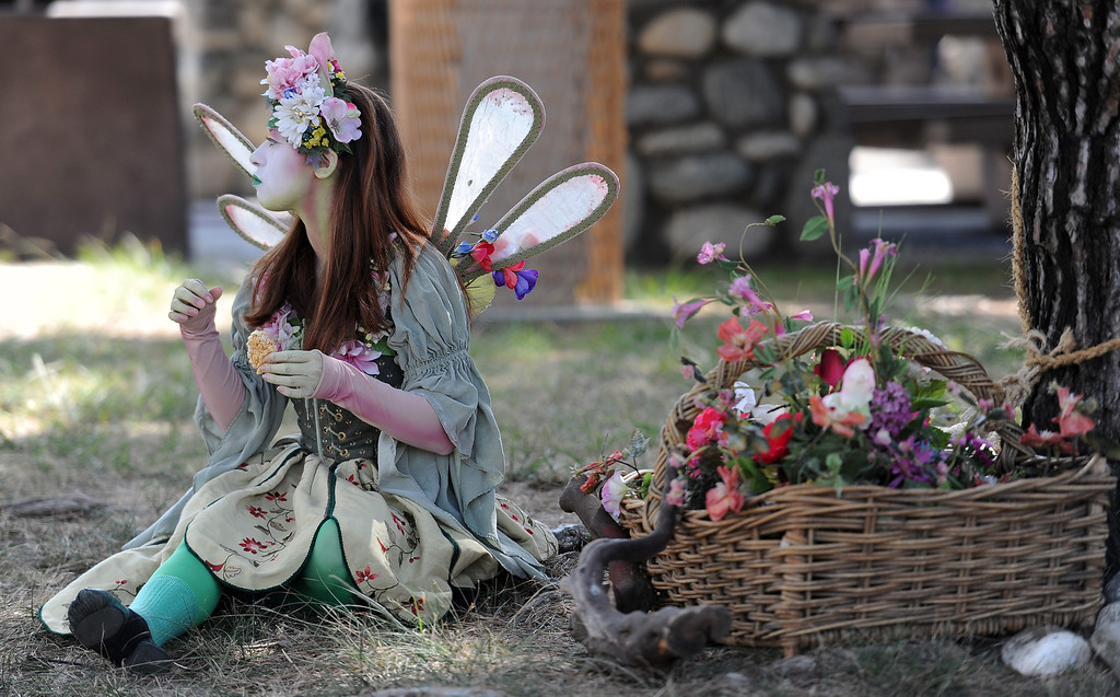 Description of . A pixie on opening day of the Renaissance Pleasure Faire at Santa Fe Dam Recreation Area in Irwindale, Calif., on Saturday, April 5, 2014. 