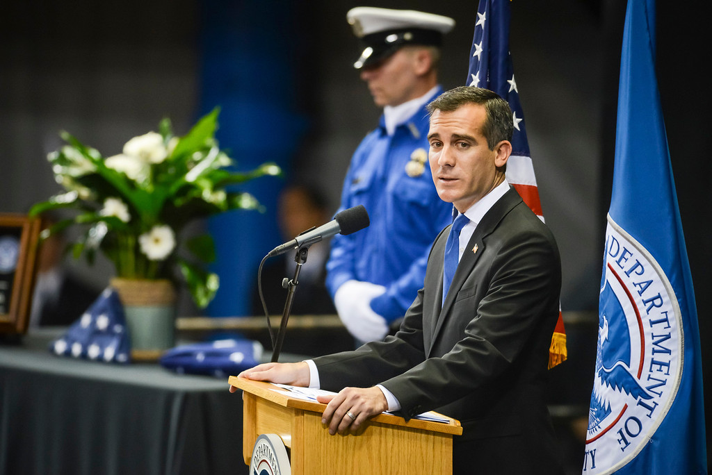 Description of . Los Angeles Mayor Eric Garcetti speaks at the memorial for slain TSA officer Gerardo Hernandez at the Los Angeles Sports Arena Tuesday, November 12, 2013.  A public memorial was held for Officer Hernandez who was killed at LAX when a gunman entered terminal 3 and opened fire with a semi-automatic rifle, Grigsby was wounded in the attack.  ( Photo by David Crane/Los Angeles Daily News )