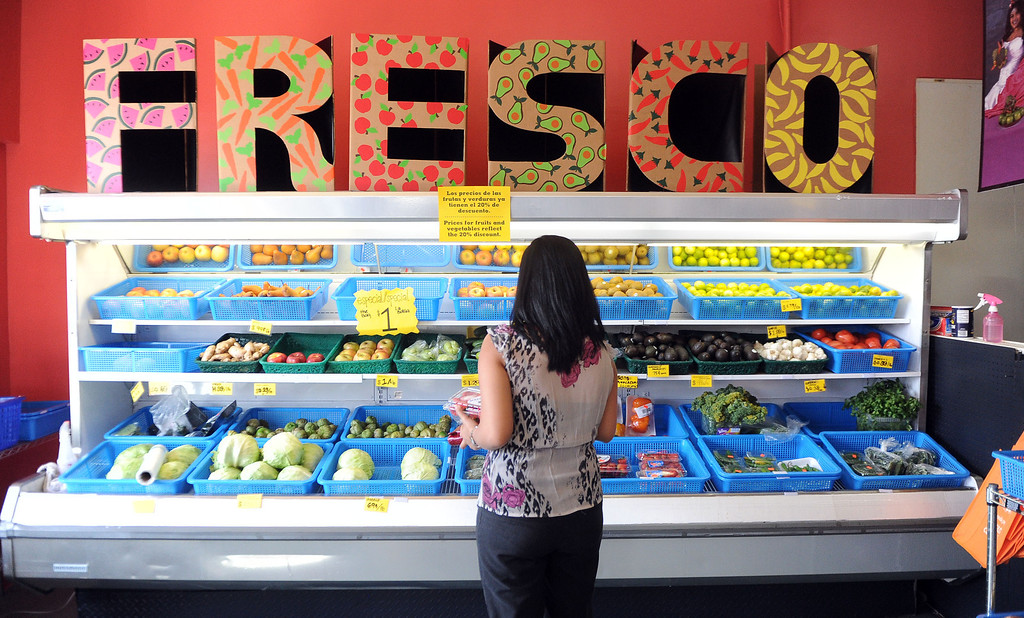 Description of . Locals shop for fresh produce after a press conference announcing new data on the availability and marketing of tobacco, alcohol and food products in stores at Euclid Market in Los Angeles on Wednesday, March 5, 2014.  (Keith Birmingham Pasadena Star-News)