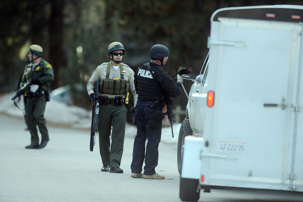 Description of . Law enforcement search door-to-door for ex-LAPD officer Christopher Jordan Dorner near Bear Mountain in Big Bear Thursday February 7, 2013.(Staff photo by Will Lester/Inland Valley Daily Bulletin)