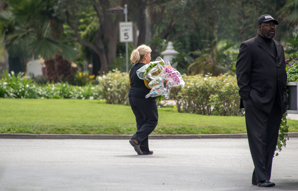 Description of . A woman carries flowers outside  Hollywood Forever Cemetery during the funeral of Mick Jagger's  girlfriend LWren Scott  in Hollywood, California on March 25, 2014.  The model-turned-fashion designer was found hanged in her luxury New York apartment last week. She was 49. The cemetery was closed for the roughly one-hour service, held amid tight security.           (JOE KLAMAR/AFP/Getty Images)