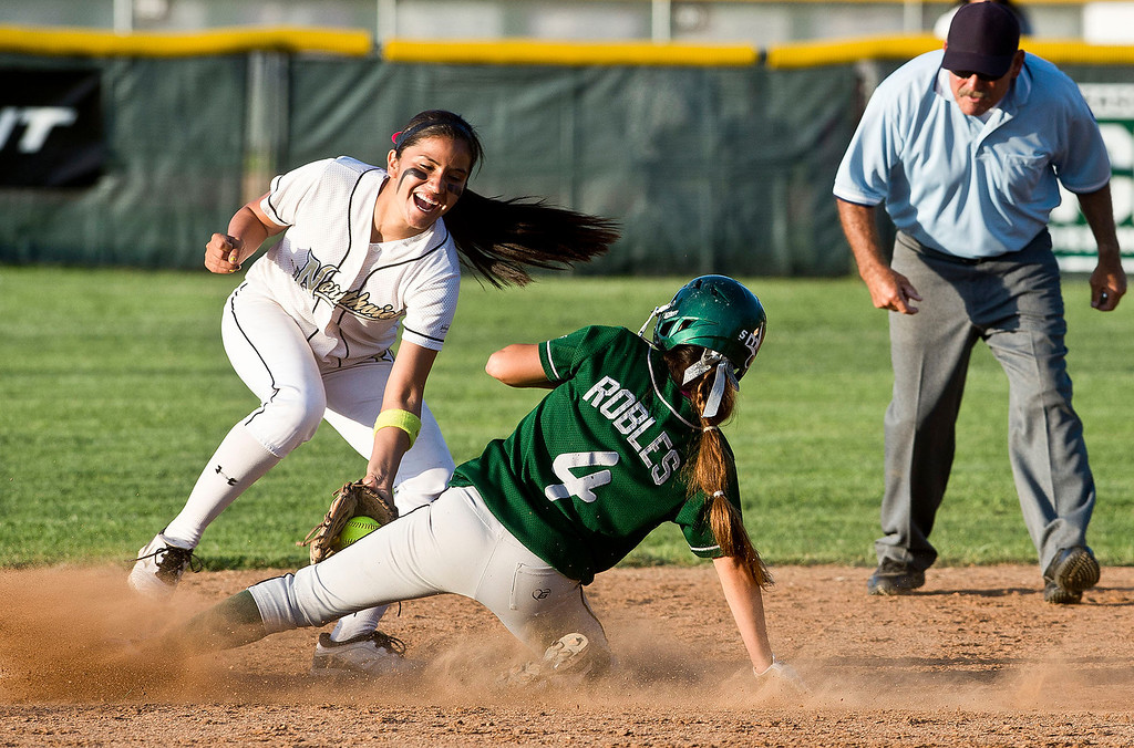 Description of . Northview's Sarina Jaramillo (#20) tags out South Hills' Lexi Robles (#4) in the sixth inning during San Gabriel Valley all-star softball game at Diamond Bar High School on Monday, June 3, 2013. South team won 10-5. (Staff photo by Watchara Phomicinda/ Los Angeles Media News Group)