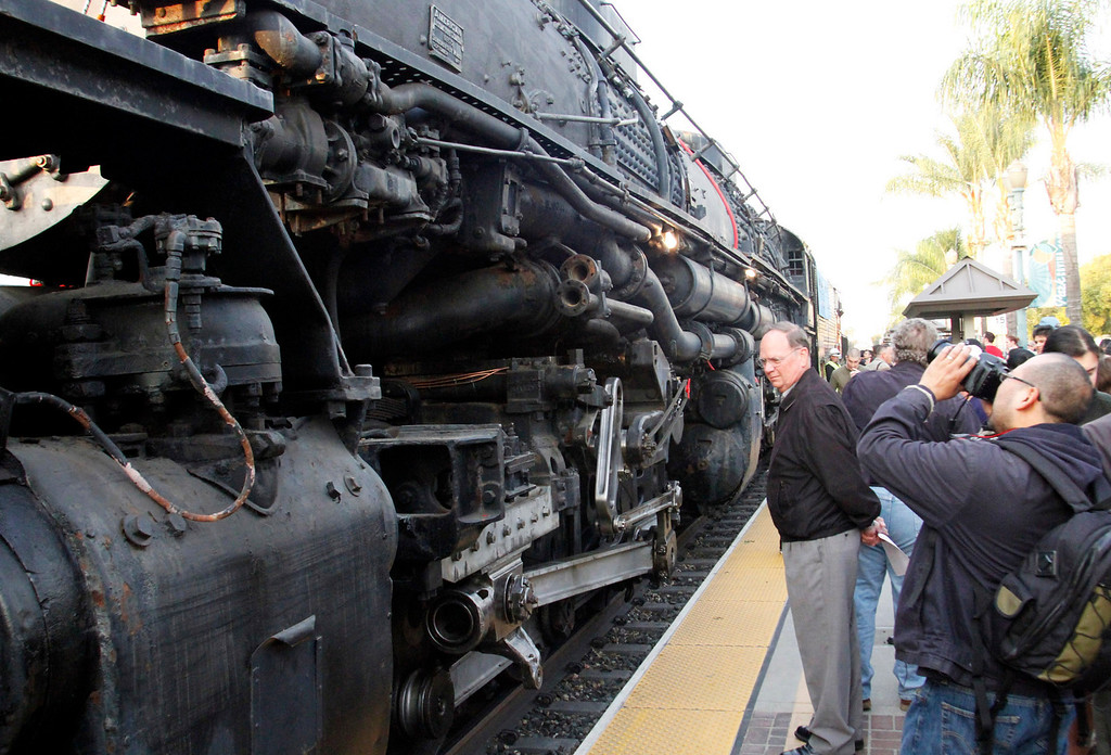 Description of . People admire the historic Big Boy train, weighing 1,200,000 pounds, as it stopped at the Covina Metrolink Station for an hour on its way to Union Pacific's Heritage Fleet Operations headquarters in Cheyenne, Wyoming, at the Covina Metrolink Station in Covina, CA., Sunday, January 26, 2014. (Photo by James Carbone for the San Gabriel Valley Tribune)