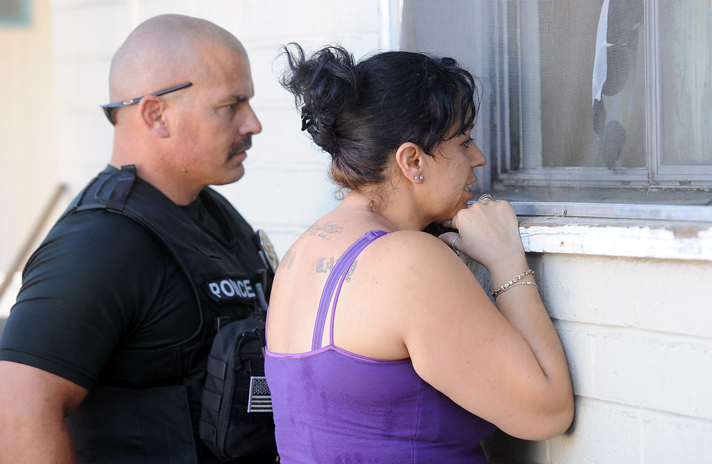 Description of . (Will Lester/Inland Valley Daily Bulletin) The Pomona Police Department, along with assistance from other law enforcement agencies, conducted a Gang Saturation Sweep Saturday August 17, 2013.
