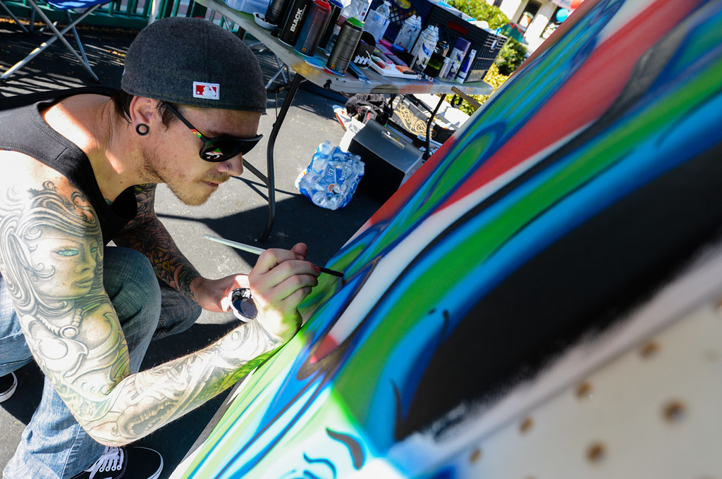 Description of . Artist Shane Hibbetts creates a painting during the Turn Up the Vote event at Court Street Square in San Bernardino on Sunday, Oct. 20, 2013. Zealous Creative and San Bernardino Generation Now hosted the event in effort to encourage young adults to participate in the November 5 election. (Rachel Luna / San Bernardino Sun)