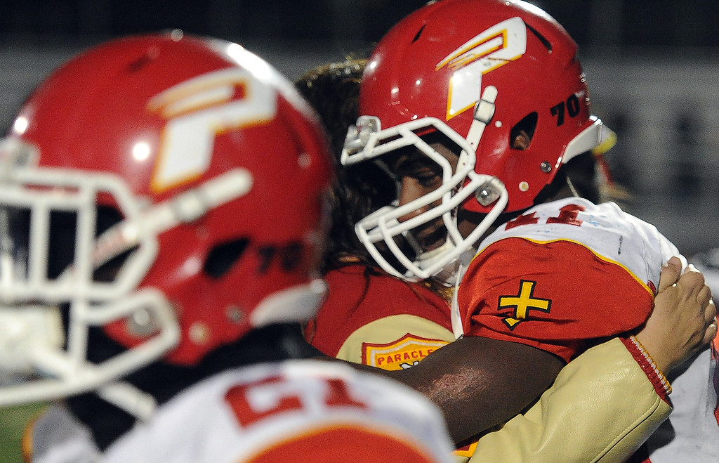 Description of . Paraclete's Melquise Stovall, right, is consoled after losing to San Dimas 20-14 a CIF-SS Mid-Valley Division championship football game at San Dimas High School in San Dimas, Calif., on Friday, Dec. 6, 2013.   (Keith Birmingham Pasadena Star-News)