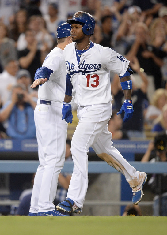 Description of . Hanley Ramirez #13 of the  Los Angeles Dodgers reacts to his two run homerun to take a 2-0 lead over the Cincinnati Reds during the seventh inning at Dodger Stadium on July 26, 2013 in Los Angeles, California.  Dodgers won 2-1.   (Photo by Harry How/Getty Images)
