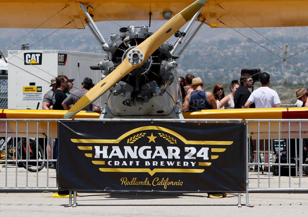 Description of . The Hangar 24 AirFest and 6th Anniversary Celebration takes place on Friday, May 16, 2014 at the Redlands Municipal Airport in Redlands, Ca. (Photo by Micah Escamilla/Redlands Daily Facts)