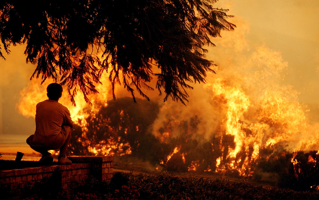 Description of . Ten years ago this month the arson caused Old Fire, fanned by Santa Ana winds burned thousands of acres, destroyed hundreds of homes and caused six deaths. The fire burned homes in San Bernardino, Highland, Cedar Glen, Crestline, Running Springs and Lake Arrowhead and forced the evacuation of thousand of residents. (Staff file photo/The Sun)