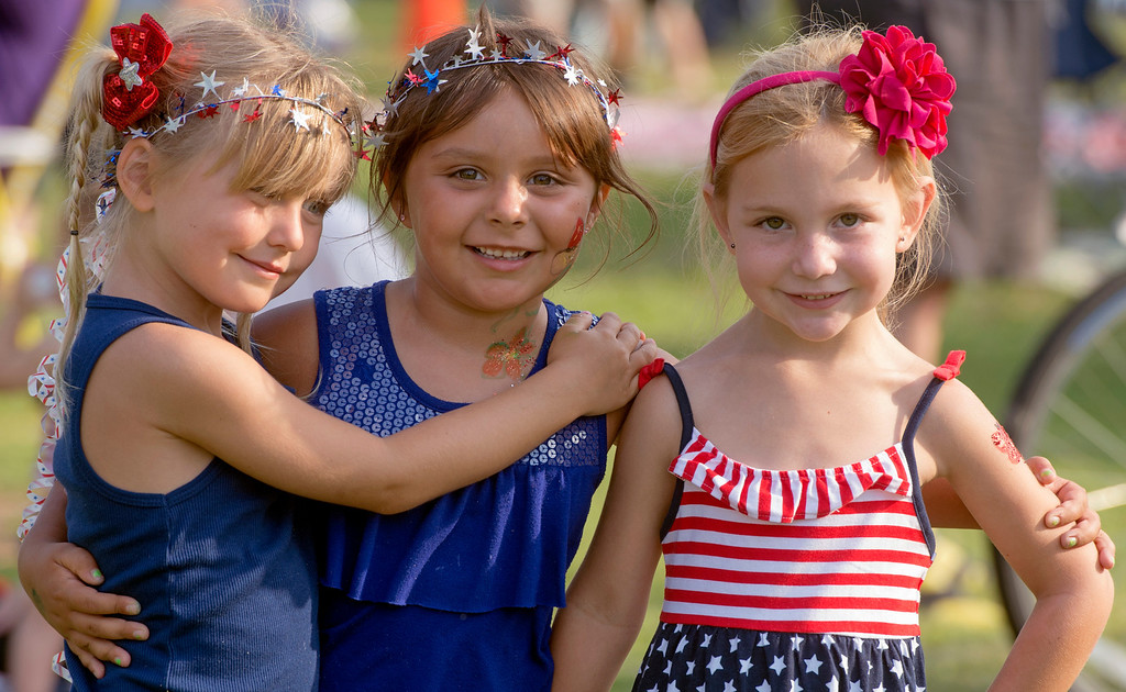 Description of . Kennadi Spurgeon, from left, Julia Raucho and Hailey Ervolina, all five years old, wear patriotic headbands for La Mirada's annual Independence Day Celebration at La Mirada Regional Park July 3, 2013.   (SGVN/Staff photo by Leo Jarzomb)
