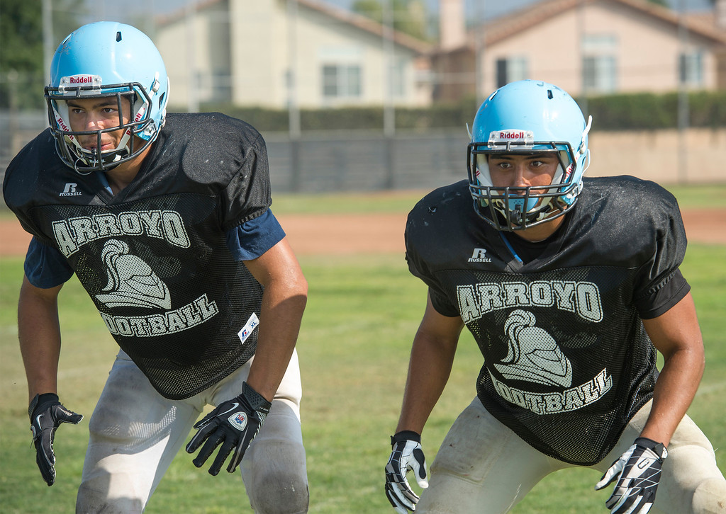 Description of . Arroyo High linebackers Jesus Calvillo and Jose Valdivia during preseason practice at the El Monte campus August 14, 2013.   (SGVN/Staff photo by Leo Jarzomb)