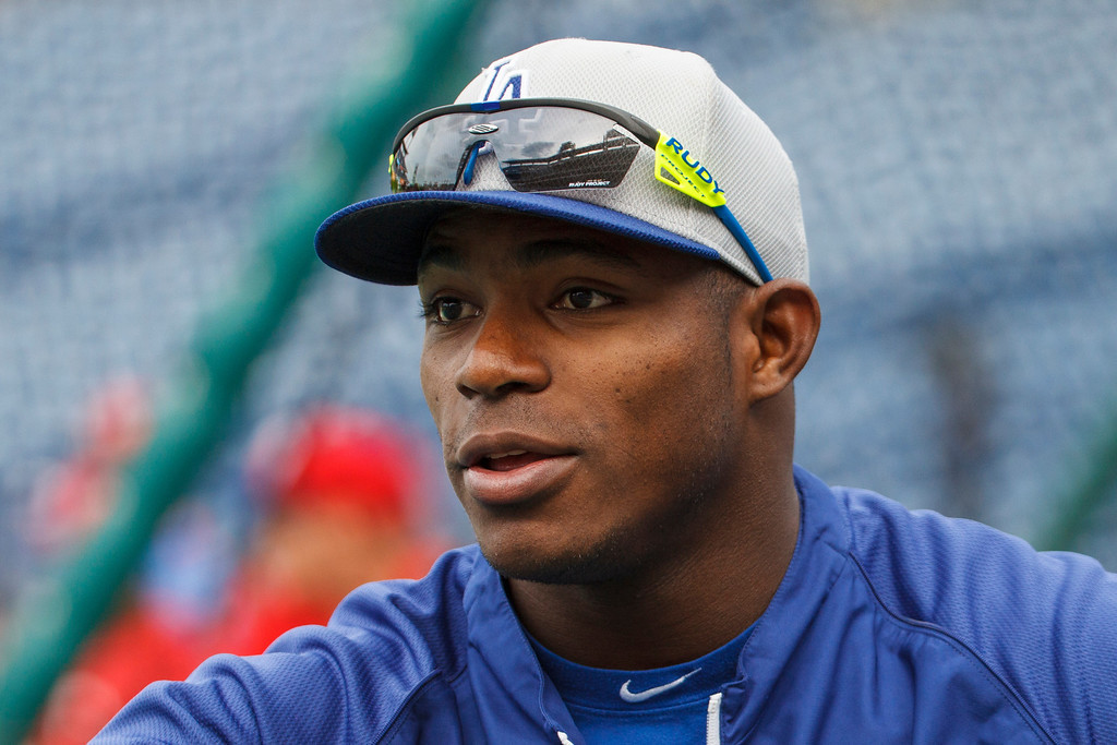 Description of . Los Angeles Dodgers' Yasiel Puig looks on as the team warms up before a baseball game against the Philadelphia Phillies, Friday, Aug. 16, 2013, in Philadelphia. (AP Photos/Christopher Szagola)