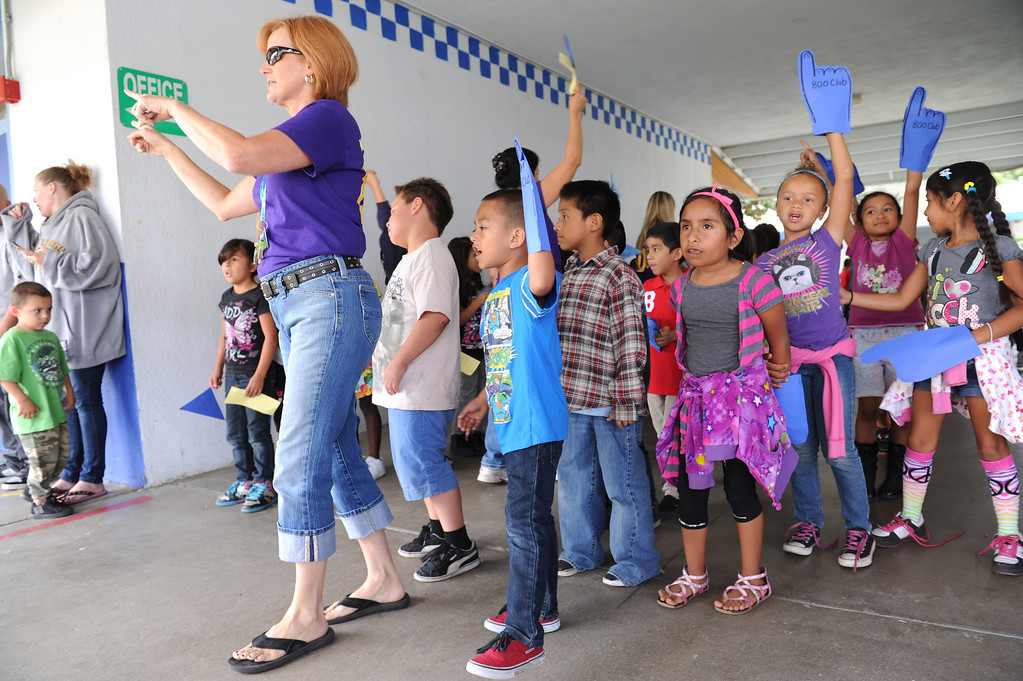 Description of . (John Valenzuela/Staff Photographer)  Lugonia Elementary in Redlands celebrated its 808 API score, Thursday, with a pep rally at the school, September 26, 2013.  The Citrus Valley Marching Band was on hand to help celebrate, in honor of the event all of the school staff wear purple shirts with the words