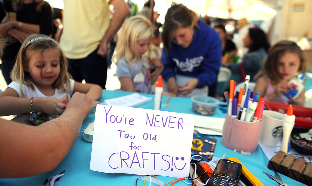 Description of . Kids and adults make crafts during the 8th Annual Pasadena ARTWalk along El Molino Avenue between Colorado Boulevard and  Green Street in Pasadena, Calif., on Saturday, Oct. 12, 2013. The ArtWalk features over 30 participating artists, art sales, gallery walks, musical performances and other activities.   (Keith Birmingham Pasadena Star-News)