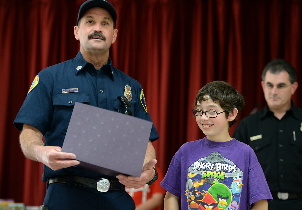 Description of . Valle Vista Elementary School fifth grader Hayden Pestel, 10, was recognized as a hero Tuesday February 11, 2014 by the Rancho Cucamonga fire department. Pestel awoke his sleeping grandfather Thursday night after the laundry room in his home caught fire allowing them both to escape the fire without injury. Damage to the home was set at $230,000. (Will Lester/Inland Valley Daily Bulletin)