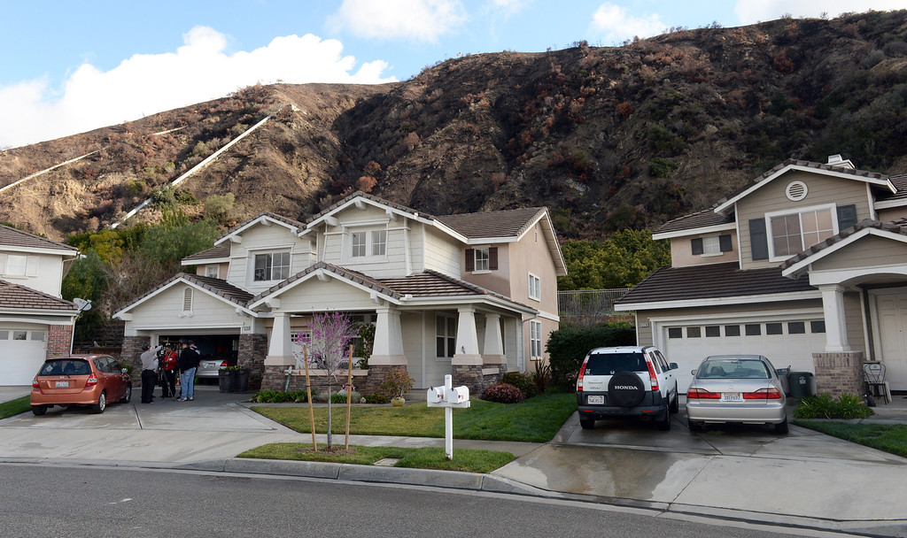 Description of . Residents on Ridge View Drive n Azusa are facing a mandatory evacuation in case the mud from the hills slides down ion Thursday February 27, 2014. (Staff Photo by Keith Durflinger/San Gabriel Valley Tribune)