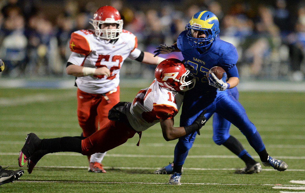 Description of . San Dimas' Joseph Mayorga (23) runs for a first down as Paraclete's Melquise Stovall makes the tackle in the second half of a CIF-SS Mid-Valley Division championship football game at San Dimas High School in San Dimas, Calif., on Friday, Dec. 6, 2013. San Dimas won 20-14.  (Keith Birmingham Pasadena Star-News)