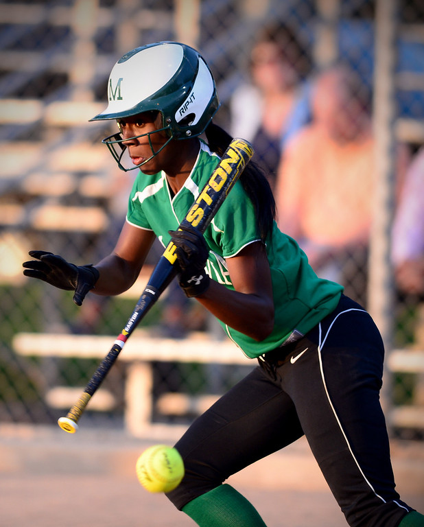 Description of . Monrovia's Elise McCarthy (4) makes a double on a bunt during the West SGV softball all-star game Wednesday night, June 11, 2014 at Live Oak Park in Temple City. (Photo by Sarah Reingewirtz/Pasadena Star-News)