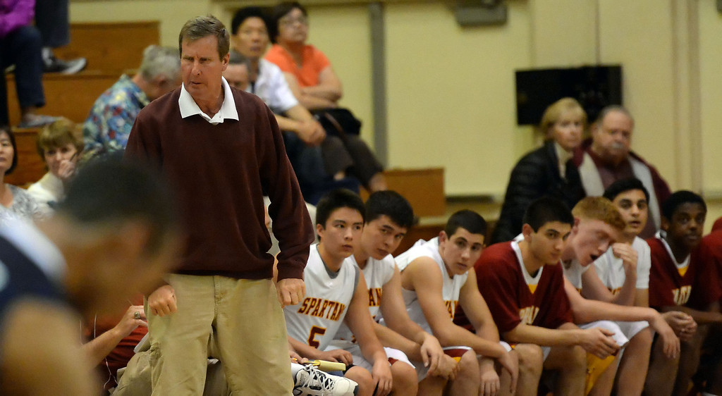 Description of . La Canada head coach Tom Hofman reacts in the first half as they defeated La Salle 73-62 for coach Hofman's 600th win during a prep basketball game at La Canada High School in La Canada, Calif., on Friday, Jan. 10, 2014. Hofman record is 600 wins and 186 losses since becoming varsity head coach in the 1986-87 season. (Keith Birmingham Pasadena Star-News)