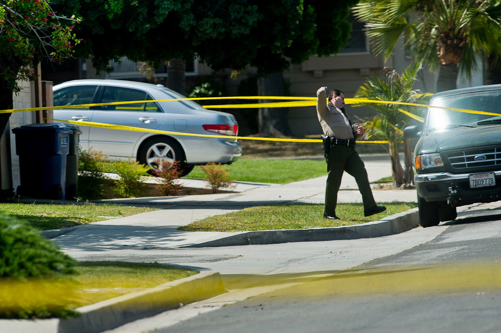 Description of . Los Angeles sheriff's officials investigate at a home in the 15900 block of Ladysmith Street in Hacienda Heights where two elderly women and an elderly man were found fatally shot on Wednesday, May 1, 2013. (SGVN/Staff photo by Watchara Phomicinda)