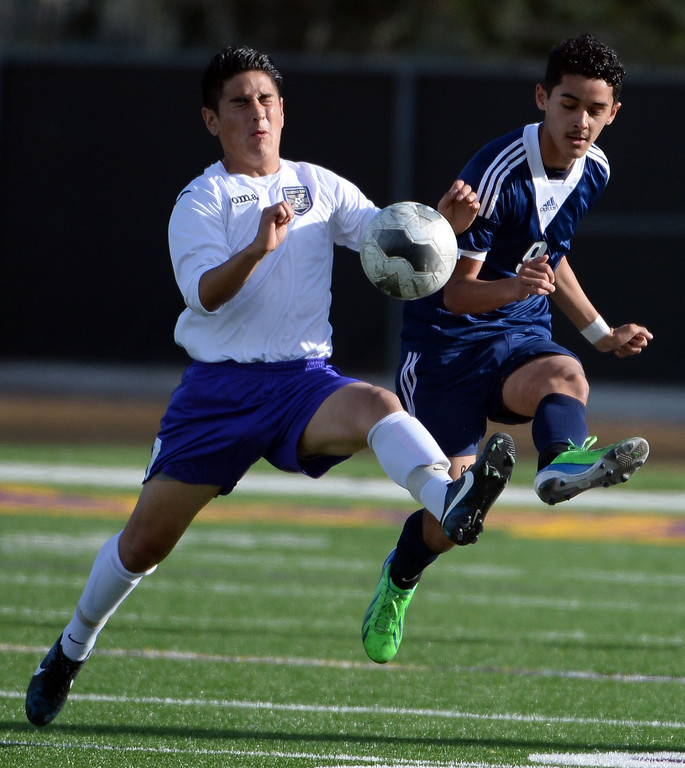 Description of . Diamond Bar's Andrew Holguin (7) controls the ball past Baldwin Park's Eduardo Suarez (9) in the first half of a CIF-SS quarterfinal prep playoff soccer match at Diamond Bar High School in Diamond Bar, Calif., on Thursday, Feb.27, 2014. Baldwin Park won 2-1. (Keith Birmingham Pasadena Star-News)