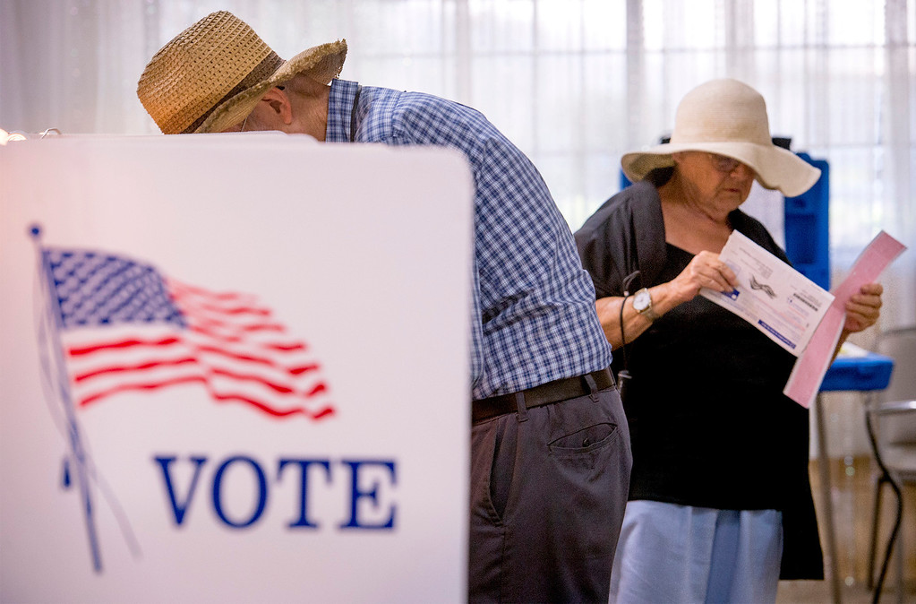 Description of . Voters cast ballots at the Greenleaf Masonic Temple on Beverly Boulevard in Whittier, Calif. Tuesday morning June 3, 2014.   (Staff photo by Leo Jarzomb/Whittier Daily News)