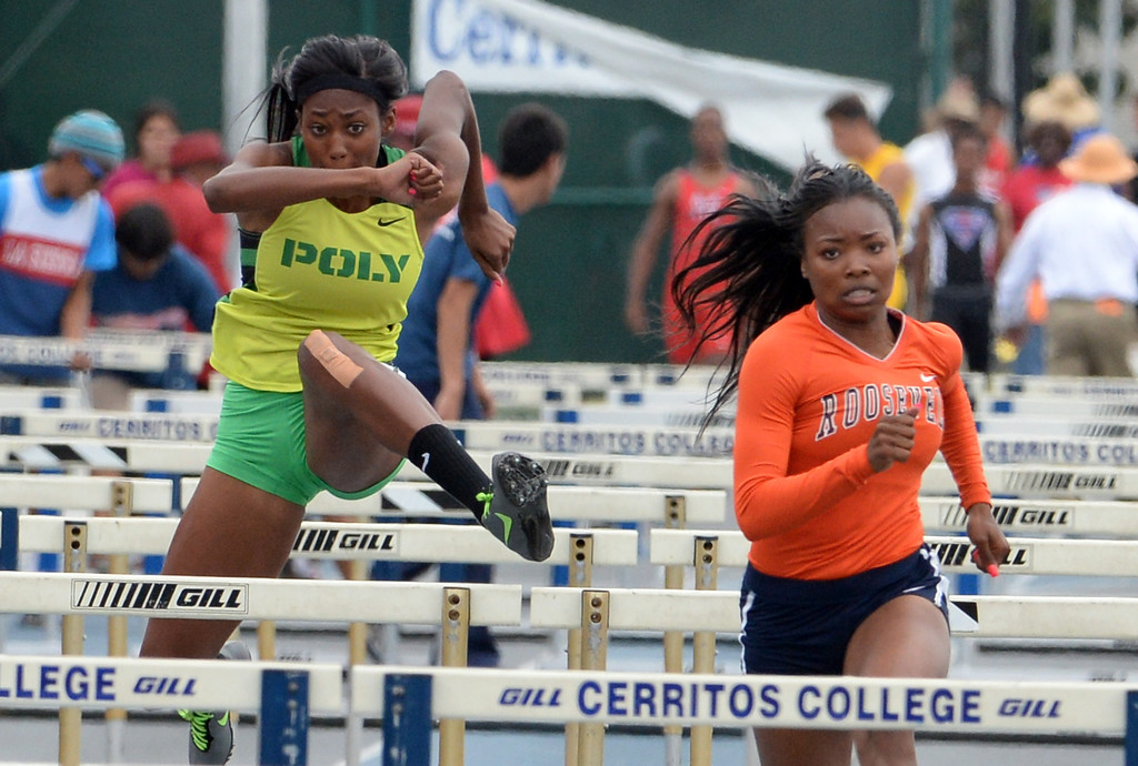 Description of . Long Beach Poly's Ebony Crear, left, with Roosevelt's Jasmyne Graham compete in the division 1 100 meter high hurdles during the CIF Southern Section track and final Championships at Cerritos College in Norwalk, Calif., Saturday, May 24, 2014. 