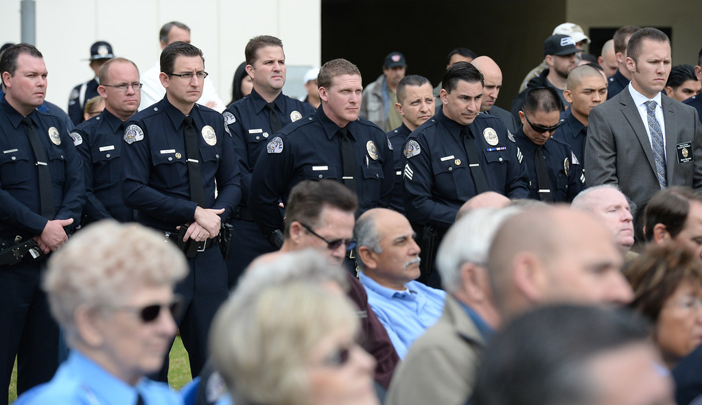 Description of . William Faulkner is sworn in as the new Police Chief during a ceremony at the West Covina Civic Center on Thursday February 6, 2014. Faulkner comes with 30 years of experience after spending much of his career at the Fontana Police Department. (Staff Photo by Keith Durflinger/San Gabriel Valley Tribune)