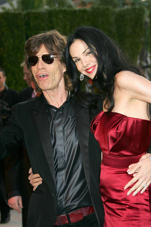 Description of . Singer Mick Jagger and his girlfriend L'Wren Scott arrive at the Vanity Fair Oscar Party at Mortons on March 5, 2006 in West Hollywood, California.  (Photo by Evan Agostini/Getty Images)