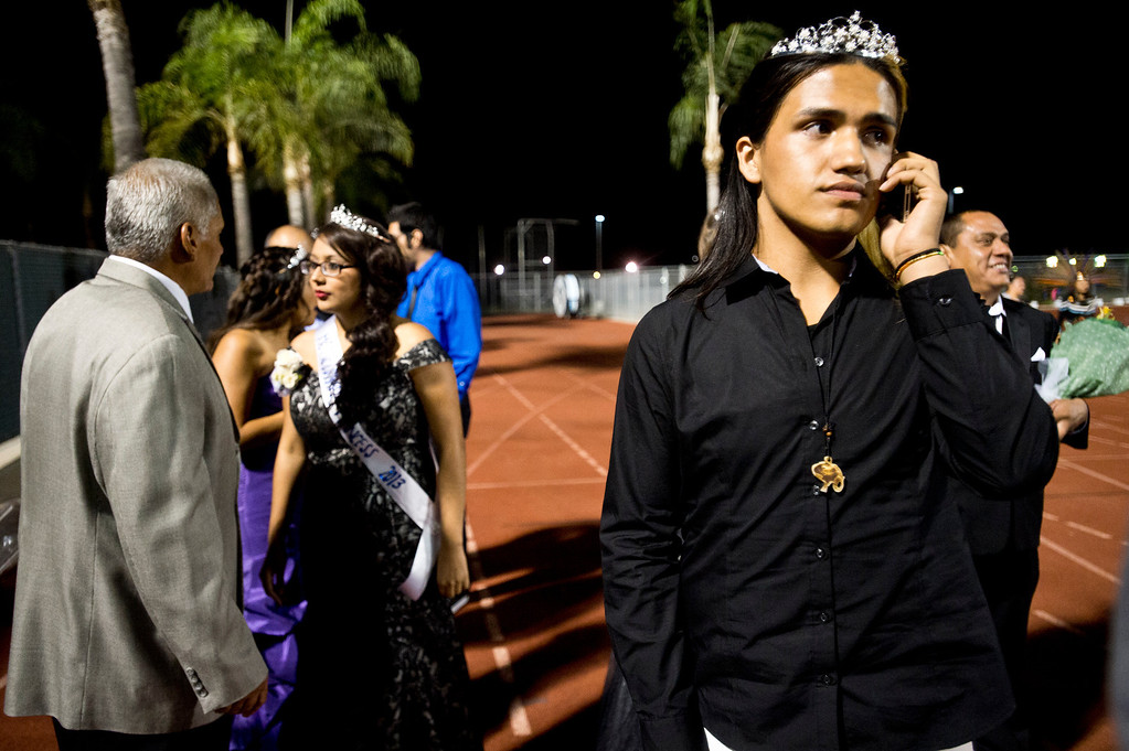 Description of . Patrick Cordova, 16, a transgender senior, waits for his dad to accompany him in the homecoming halftime at Citrus College Stadium in Glendora on Friday night, Sept. 27, 2013. (Photo by Watchara Phomicinda/ San Gabriel Valley Tribune)