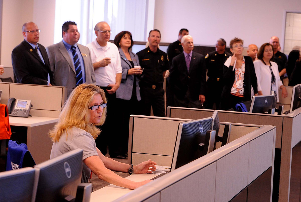 Description of . Emergency Services officer Robin Lindsey conducts a demonstration of the Emergency Operations Center during a tour of the High Desert Public Safety Operations Center in Hesperia May 10, 2013.  GABRIEL LUIS ACOSTA/STAFF PHOTOGRAPHER.