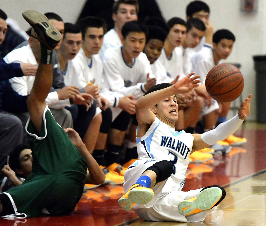 Description of . Walnut's Rob Harrelson (C) (3) recovers a loose ball against Damien in the first half of the Glendora basketball tournament at Glendora High School in Glendora, Calif., on Friday, Dec. 13, 2013. Damien won 66-60.  (Keith Birmingham Pasadena Star-News)