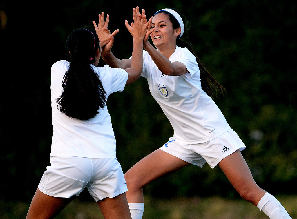 Description of . Bishop Amat's Jamie Peters, right, high fives teammate Nicole Diaz after scoring against Marshall in the first half of a prep soccer match at Bishop Amat High School in La Puente, Calif., on Thursday, Jan. 9, 2014.Amat won 3-0. (Keith Birmingham Pasadena Star-News)