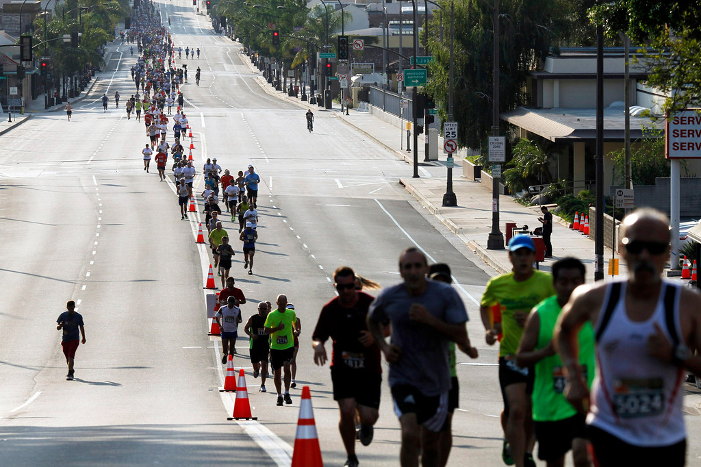 Description of . Participants run west on Colorado boulevard during the 5th Annual Pasadena Marathon Event, in Pasadena, Sunday, June 30, 2013. (SXCITY/Correspondent Photo by James Carbone)