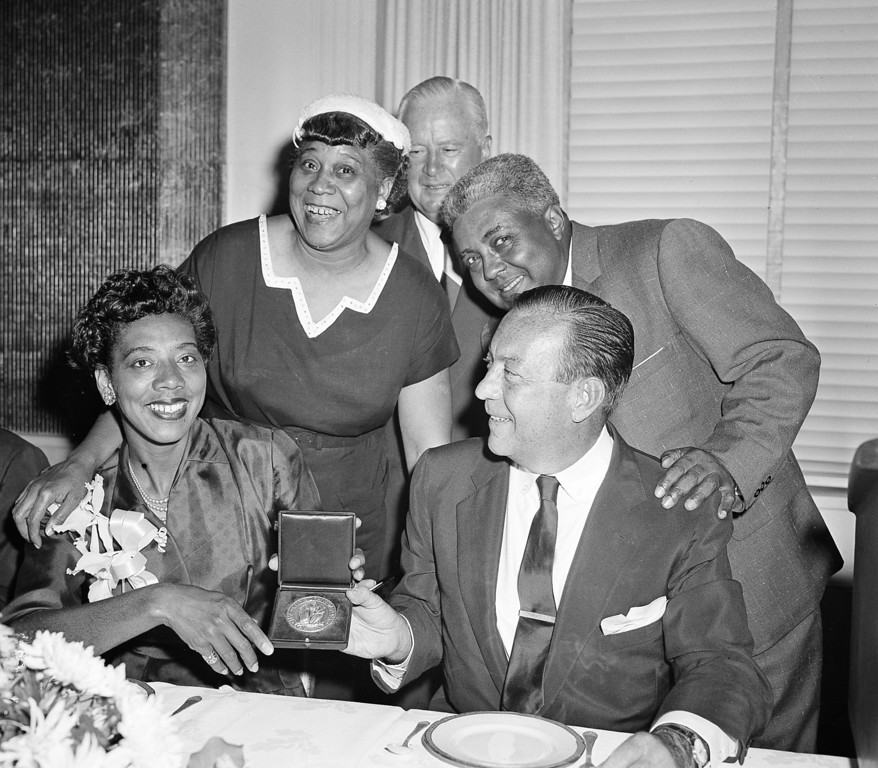 Description of . New York\'s Althea Gibson and Australia\'s Mal Anderson hold their trophies after their victories in the National Tennis Championships at Forest Hills, N.Y., Sept. 8, 1957.  Others are unidentified.  (AP Photo/Harry Harris)